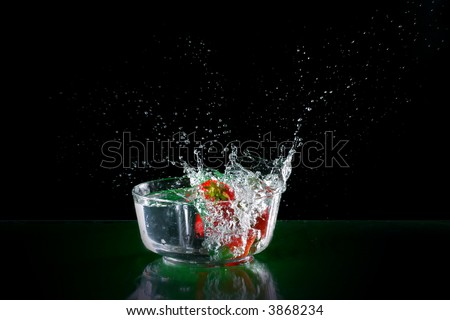 The fruits splash into glass of water