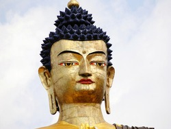 The 130 ft tall golden statue of Lord Buddha perched at Tathagata Tsal in Buddha Park, Ravangla South Sikkim. Relics of Buddha brought from Malaysia, Singapore, Sri Lanka, Cambodia kept inside statue.