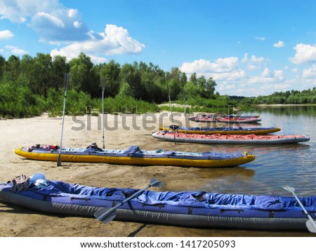 The fun Rafting on kayaks in an amazing place. Strong trees, fast water, fresh air, fire in nature, beautiful clouds, camping, funs, slacklining between the trees, sport and just a w