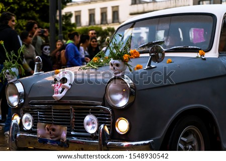 The funeral car parades through the streets of the historic center of Guadalajara on the day of the dead.