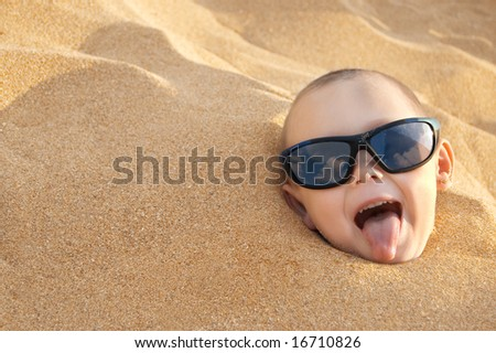 the funny boy in sand