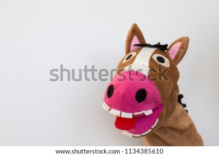 the funny donkey puppet show on the white background for school activity time.  #1134385610