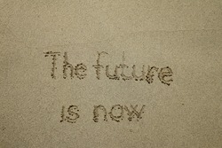 The future is now - the future is now, innovative technology concept text written on sand