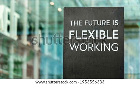 The future of work is Flexible sign in front of a modern office building Foto stock ©