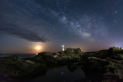 The Galaxy and the Moon over the lighthouse, near Ahtopol Bulgaria