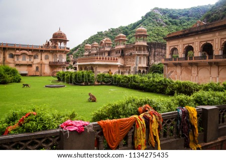 The Galtaji Hindu Temple or Monkey Temple near the city of Jaipur in Rajasthan, India. The site consists of a series of temples built into a narrow crevice in the ring of hills that surrounds Jaipur.