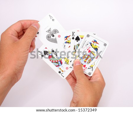 The game, playing cards in a men hands
