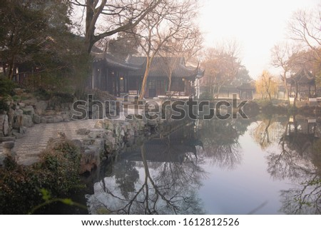 The garden at Humble Administrator Garden(Zhuozheng Garden) in a mist early morning.Zhuozheng Garden a classical garden,a UNESCO World Heritage Site and is the most famous of the gardens of Suzhou.
