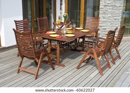 The Garden furniture by the house patio and with place setting