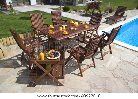 The Garden furniture by the pool w place setting