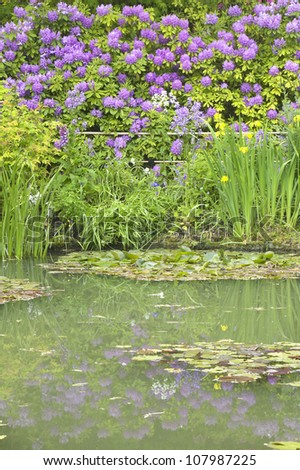 The Gardens at Giverny with Monet's Bridge and waterlilies, Giverny, France - stock photo