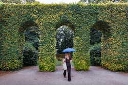 The gardens of The Musée Rodin in Paris, France with woman walking