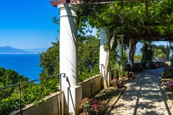 The gardens of Villa San Michele in Capri have a scenic panoramic view of Gulf of Naples and Sorrentine Peninsula, Italy