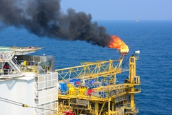 The gas flare is on the offshore oil rig platform