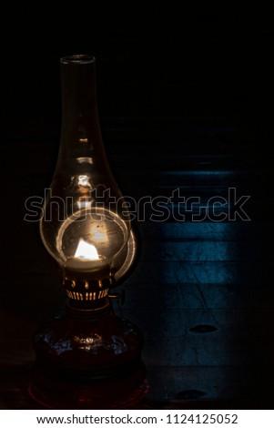 The gas lamp illuminates the darkness #1124125052