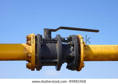 The gas valve on the background of clear blue sky. Blocking damper on gas pipe