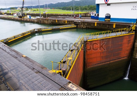 The gates at the Gatun Locks on the Panama Canal with the pool in the background