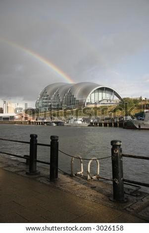 the gateshead sage music hall captured with a rainbow behind it #3026158