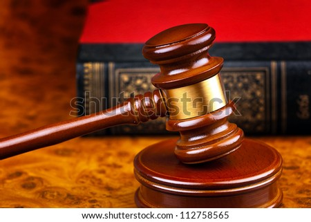 the gavel of a judge in court. lying on a desk.