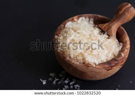 The gellant agent agar-agar in wooden bowl ,  vegetarian substitute for gelatin, copy space