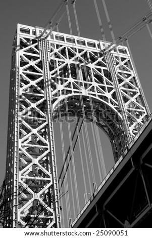 The George Washington Bridge crosses over the Hudson River from New Jersey to The Bronx, New York.  Black and white.