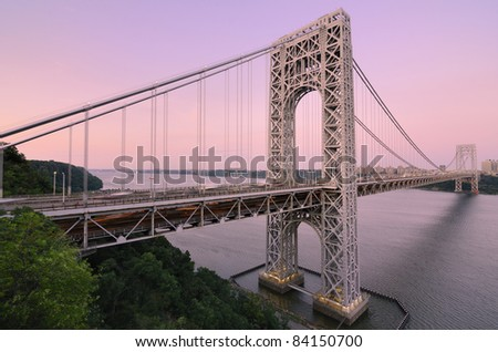 The George Washington Bridge spanning the Hudson River at twilight to connect New Jersey and New York City.
