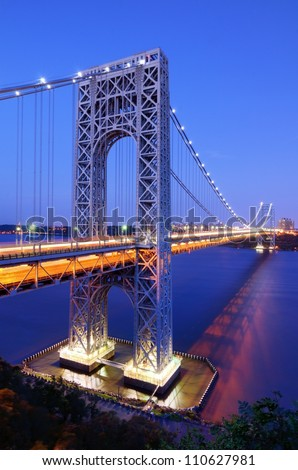 The George Washington Bridge spans the Hudson River from Fort Lee, New Jersey to the Washington Heights neighborhood in the borough of Manhattan in the city of New York, New York. - stock photo