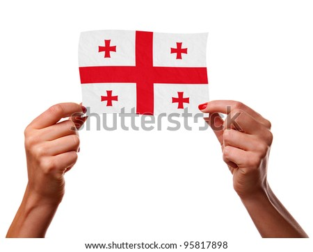 The Georgian flag in the woman hands. closeup