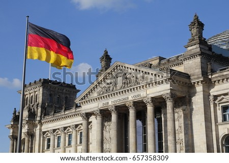 The German Bundestag with flag, a constitutional and legislative building in Berlin, capital of Germany