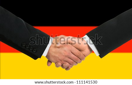 The German flag and business handshake