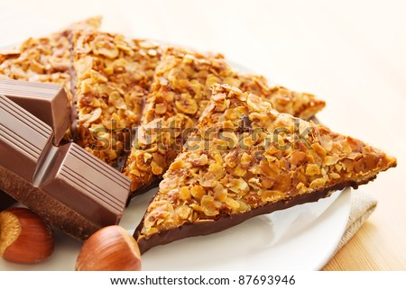The German pastry called Nussecken are a sweet nut cake cut in triangles and covered in chocolate