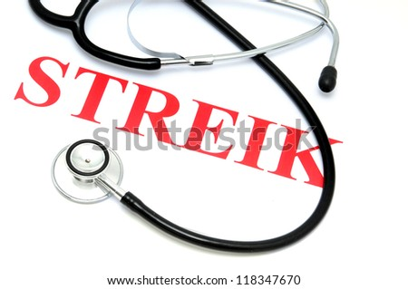 The German text Streik (strike) and a stethoscope as symbol for a strike in the medical business
