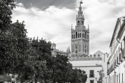 The Giralda is the bell tower of the Seville Cathedral in Seville, Spain. It was originally built as the minaret for the Great Mosque of Seville in al-Andalus, Moorish Spain, during the reign of the