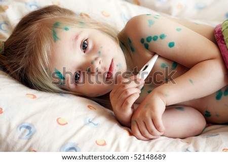 The girl, a sick chickenpox, temperature measurement
