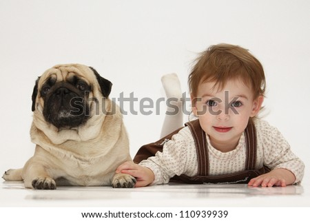 The girl and her friend the dog pug - stock photo