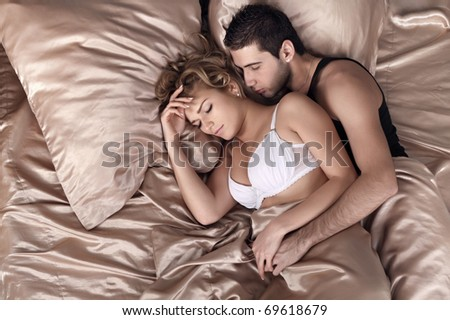 The girl and the guy sleep in a bed #69618679