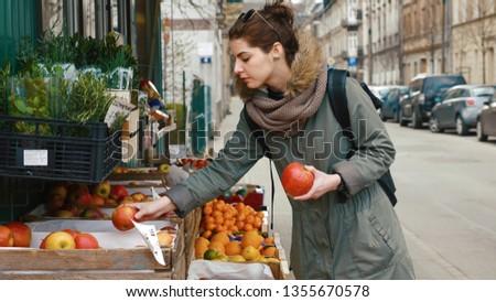The girl buys fruit