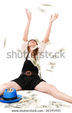The girl catches money which fall from above