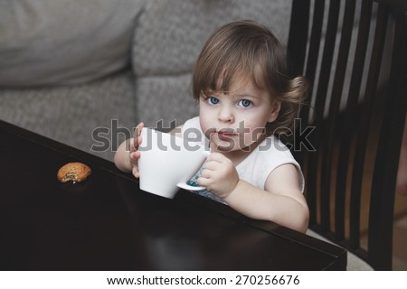 The girl child with a mug of home