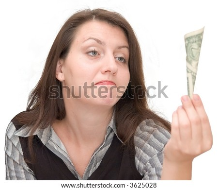The girl disappointedly looks at one dollar