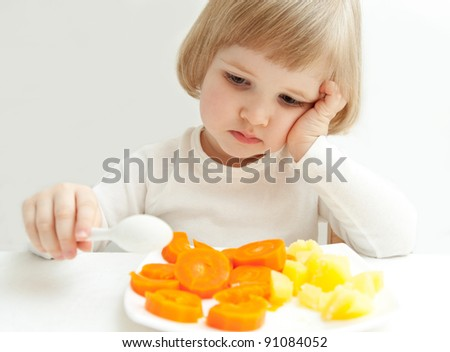 The girl doesn't want to eat  vegetables