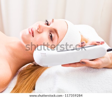 The girl doing cosmetic procedures in spa clinic