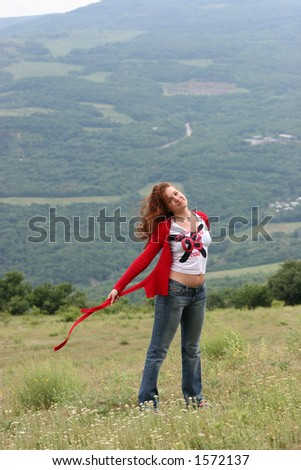 The girl enjoys rest in mountains