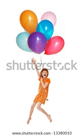 The girl flies on balloons