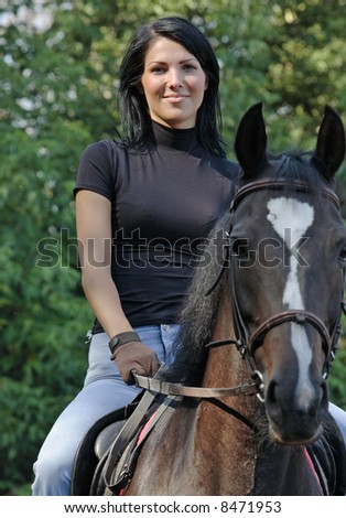 The girl goes for a drive on a horse
