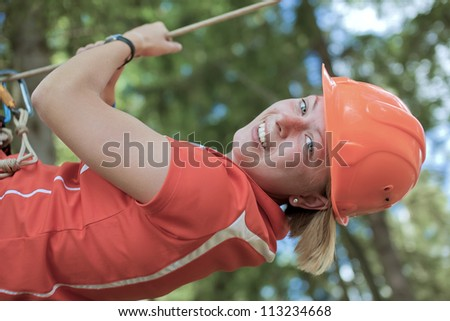 The girl hangs on a rope