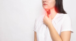 The girl holds her neck with a thyroid gland with her hand on a white background. Thyroid diseases and problems concept, lack of iodine in the body, copy space for text