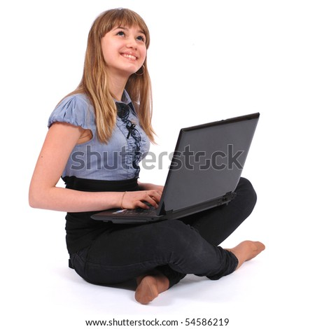 The girl holds laptop pensively looks upwards on white background