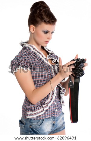 The girl holds the camera on the isolated white background