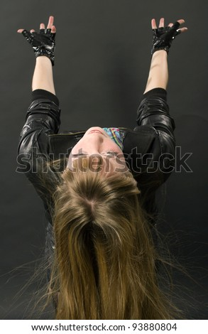The girl in a black jacket pulls hands